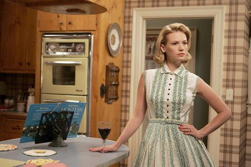 "[Molina, Genaro -- - LOS ANGELES, CA - JULY 8, 2008 -- Actress January Jones stands in the kitchen of her character Betty Draper on the set of the AMC television series, ""Mad Men,"" at Los Angeles Center Studios in Los Angeles on July 8, 2008. The actress wears a dress designed from fashions from the early 60s which is the era of the award-winning television series.] *** []"